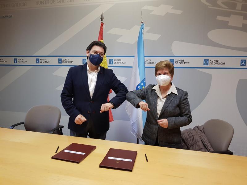 Antonio Rodríguez Miranda y Regina Jallas, durante la firma del convenio